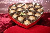 Cannabis or Marijuana Gift box. Heart Shaped Valentines Day Box with Chocolates and Marijuana Buds.  poster