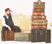 Man With Beard And Mustache Packed Luggage, White Interior Background. Macho Elegant On Tired Face S poster