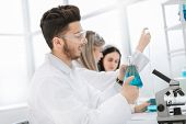 Male Researcher Carrying Out Scientific Research In A Lab poster