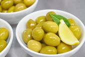 Whole Green Greek Olives In A White Bowl. Close Up. Vertical View Of Olives. poster