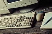 Retro Stationary Computer On A Rustic Wooden Desk, Vintage Workspace. Monitor, Keyboard, Computer Mo poster