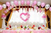 foto of wedding feast  - a laid restaurant table decorated for a wedding party - JPG