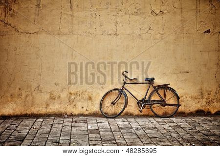 Old Vintage Bicycle Near The Wall poster