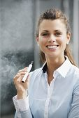 foto of smoker  - portrait of young female smoker smoking e - JPG