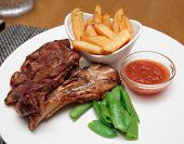 T-bone steak with french fries and hot sauce