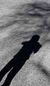 picture of child missing  - Missing child concept with shadow on street