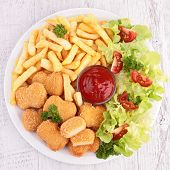 chicken nuggets, french fries and salad