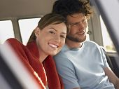 image of campervan  - Portrait of smiling young woman with boyfriend in campervan - JPG