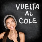 Vuelta al cole - Spanish college university student woman thinking Back to School written in Spanish