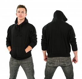 picture of hoodie  - Photo of a male in his late teens posing with a blank black hoodie - JPG