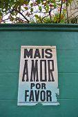 picture of por  - Mais amor por favor poster in a green wall - JPG
