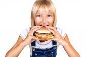 image of hamburger  - Girl eating Hamburger - JPG