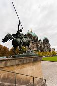 image of evangelism  - Od view of the Evangelical cathedral also known as Supreme Parish and Collegiate Church with horseman in the forefront in Berlin Germany - JPG