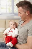 image of daddy  - Proud father holding tiny baby in arms - JPG