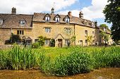 foto of slaughter  - Cotswold cottages alongside the river Eye Lower Slaughter Cotswolds Gloucestershire England UK Western Europe - JPG