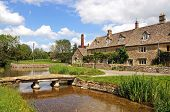 picture of slaughter  - Cotswold cottages alongside the river Eye Lower Slaughter Cotswolds Gloucestershire England UK Western Europe - JPG