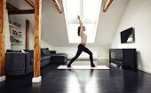 pic of yoga mat  - Full length portrait of healthy young lady going yoga workout at home - JPG