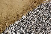 stock photo of sand gravel  - Sand and broken stone diagonal background photo - JPG