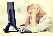stock photo of pissed off  - picture of stressed businesswoman with computer at work - JPG