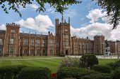 stock photo of ireland  - queens university in Belfast northern Ireland with clouds - JPG