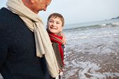 picture of grandfather  - Grandfather And Grandson Walking On Winter Beach - JPG