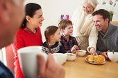 stock photo of lunch  - Multi Generation Family Eating Lunch At Kitchen Table - JPG