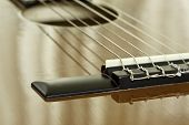picture of nylons  - Acoustic guitar bridge with metal and nylon strings - JPG