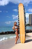stock photo of waikiki  - Surfing girl with surf board on waikiki beach - JPG