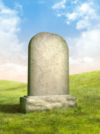 picture of tombstone  - Blank tombstone in a green grass meadow - JPG