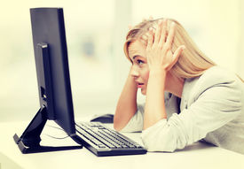 picture of pissed off  - picture of stressed businesswoman with computer at work - JPG