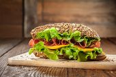 pic of tomato sandwich  - Sandwich on the wooden table with slices of fresh tomatoes - JPG