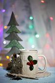 image of aquifolium  - Christmas composition with cup of hot drink - JPG