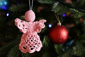 picture of christmas angel  - Knitted Christmas angels and other decorations on Christmas tree background - JPG