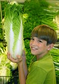 foto of grocery store  - boy in produce at grocery store - JPG