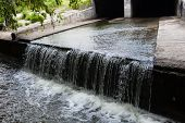 picture of underground water  - Water stream flowing out the underground tunnel into the Lybid river in Kyiv - JPG