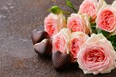 foto of valentine candy  - chocolate candy hearts and pink roses for Valentine - JPG
