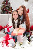 image of blanket snow  - Festive mother and daughter wrapped in blanket with gifts against snow falling - JPG