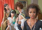 stock photo of smoking woman  - Black woman surprised with group of adults smoking pot - JPG