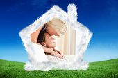 stock photo of fiance  - Woman kissing her fiance on the forehead against green field under blue sky - JPG