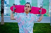 image of prank  - Young stylish man in bright summer clothes standing with pink long - JPG