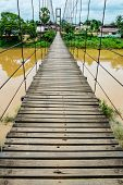 picture of shaky  - Rope suspension bridge across a river in flood, Thailand