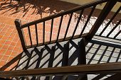 pic of bannister  - shadow of the bannister on wooden stair step - JPG