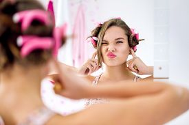 pic of ignore  - Teen girl gesture and activity not listening - JPG