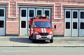 picture of fire brigade  - Fire truck near the building of the fire station - JPG