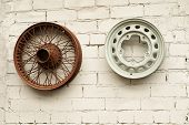 image of alloy  - two car alloy wheels hanging on the wall - JPG
