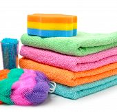 image of sea salt  - Colorful stacked spa towels sea salt mop and shampoo bottle isolated on white - JPG