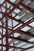 picture of tatas  - A detailed view of red steel structure and standard metal profiled decking - JPG