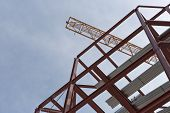 pic of tatas  - A top view of a yellow tower crane and red steel structure on a construction site - JPG