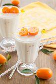 stock photo of kumquat  - Glass of milkshake made with fresh organic kumquats  - JPG