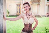 foto of corset  - Beautiful young woman in corset and shirt outdoor - JPG